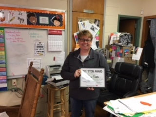 Mrs. Carter receives STOM Award