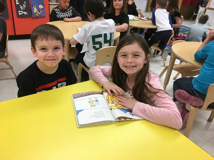 2nd Graders reading to Preschool