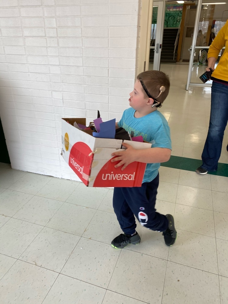 1st grade student helping with recycling