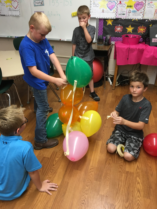Taping and building balloon tower