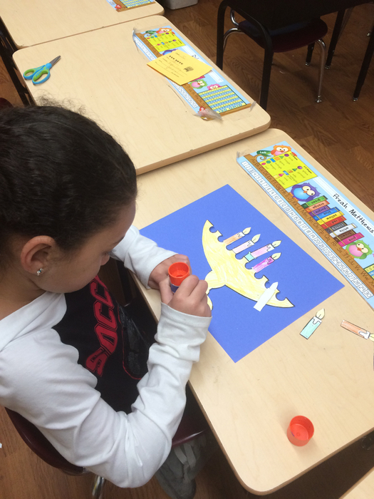 Studying about Christmas in Israel and making a menorah.