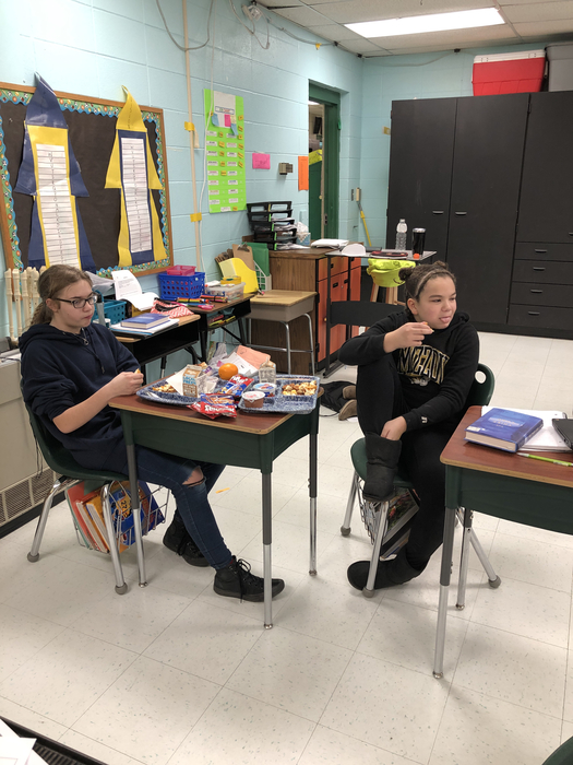 These kids earned a pizza party for reading and taking a book test over the snow/ice:cold day.
