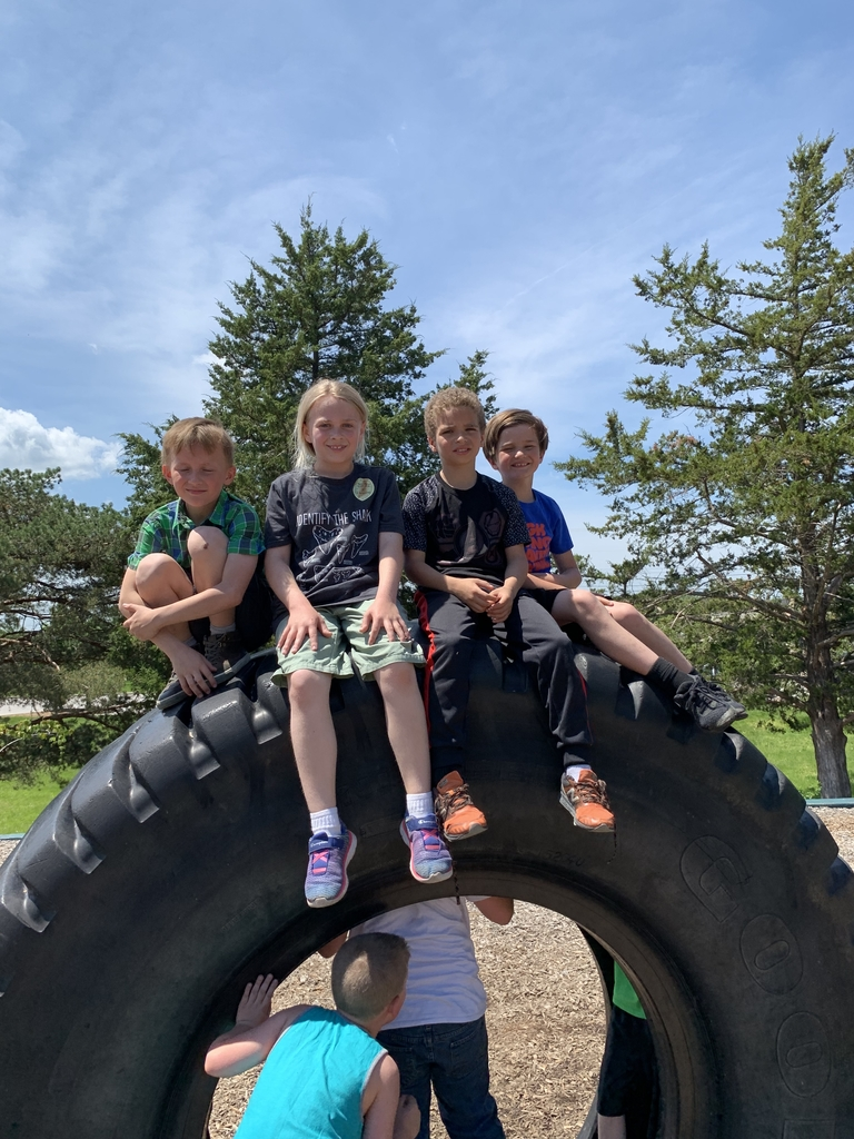 Kids on top of tire
