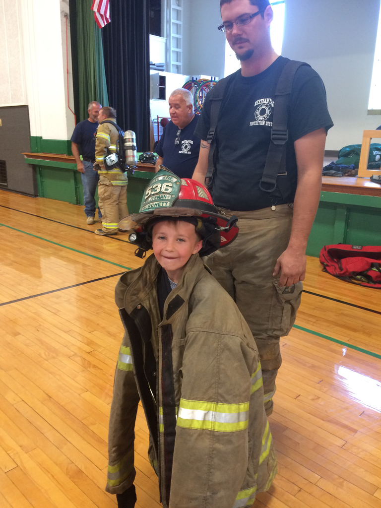 Trying on fire gear