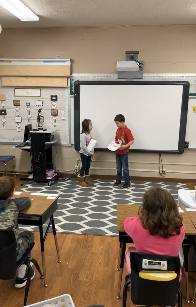 Kids presenting a play they wrote themselves